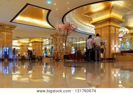 ABU DHABI, 30 MARCH 2016. Editorial Photograph of Business Men in the Lobby of the Emirates Palace Hotel.  Offering luxurious surroundings and hospitality, the hotel has been described as a 7 star facility