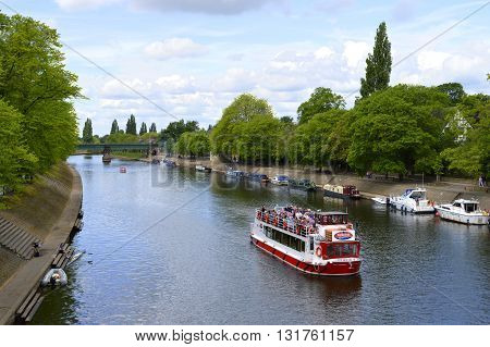 York Yorkshire England UK - May 22 2016 : Tourists cruising along river Ouse in the City of York