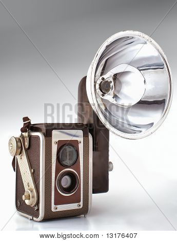 Old Photocamera With Flash Light. Isometric View
