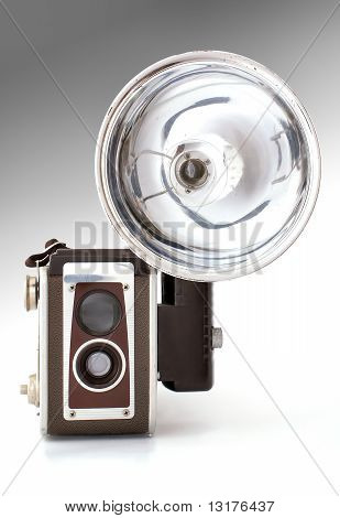 Old Photocamera With Flash Light. Front View