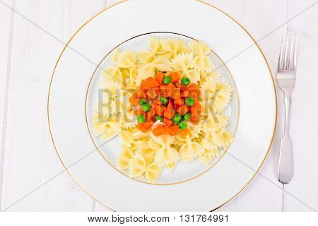 Pasta Spaghetti with Diced Carrots and Green Peas Studio Photo