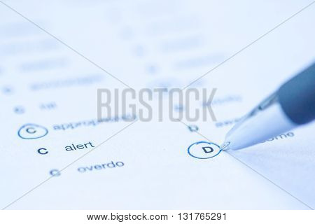 language test paper with circled answers as background