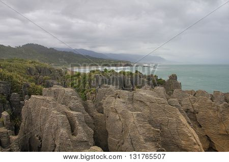 Pancake Rocks and coastline in Punakaiki New Zealand.