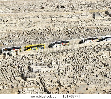 JERUSALEM, ISRAEL, 3 APRIL 2013. Editorial photograph of Tourist Coaches line the Road through the Jewish Cemetery on the Mount of Olives