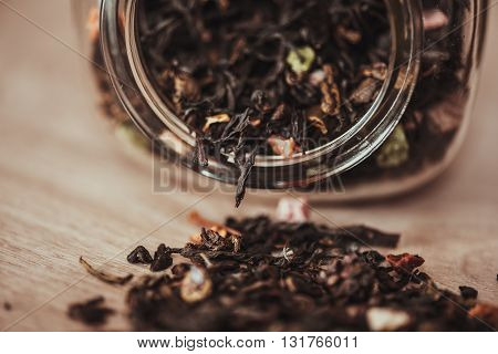 jar with scattering of black fruit tea