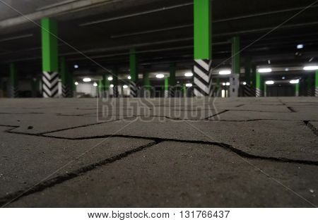 Underground car parking with green concrete pillars