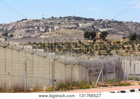 SEPARATION WALL NEAR BETHLEHEM, ISRAEL, 2 APRIL 2013. Editorial Photograph of Separation Wall Shimmering In Heat, taken from Israeli Side of Gilo 300 Gate, one of the Main Traffic routes to Jerusalem through the Wall