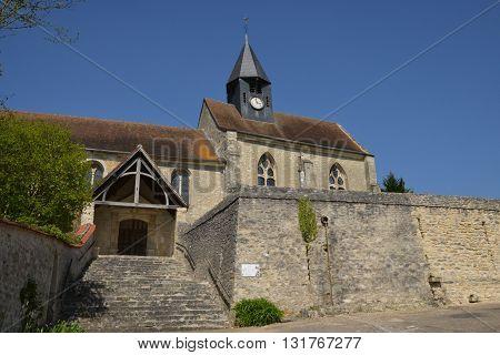 Montreuil sur Epte France - april 21 2015 : the saint Denis gothic church in spring
