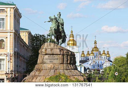 Monument of Bohdan Khmelnytsky the Hetman of Ukrainian Zaporozhian Cossacks on Sofia square in Kyiv Ukraine. St. Michael's Golden-Domed Monastery on the background