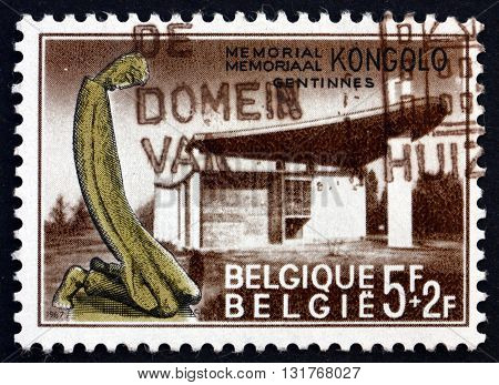 BELGIUM - CIRCA 1967: a stamp printed in the Belgium shows Kongolo Memorial Erected in Memory of Missionary and Civilian Victims in the Congo Gentinnes circa 1967