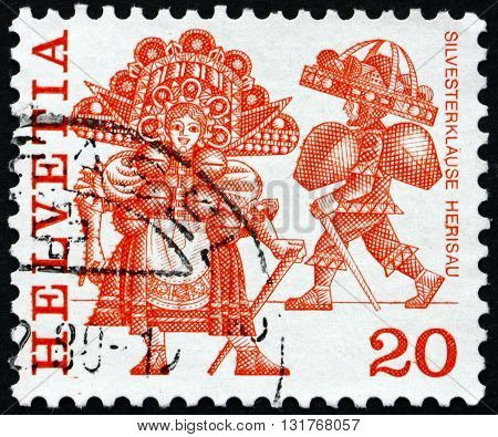 SWITZERLAND - CIRCA 1977: a stamp printed in the Switzerland shows New Year's Eve Costumes Herisau Folk Customs circa 1977