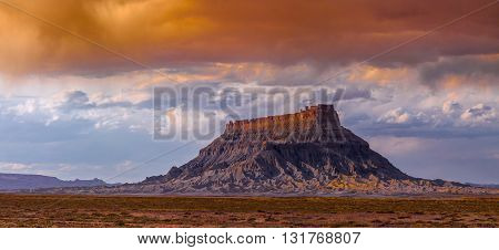 Factory Butte is the most recognizable feature of a large area of stark, barren land either side of the Fremont River known as the Upper Blue Hills, bordered by Capitol Reef to the west, the Henry Mountains to the south, San Rafael Swell to the north and