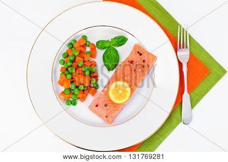 Fresh Salmon on White Plate. Studio Photo