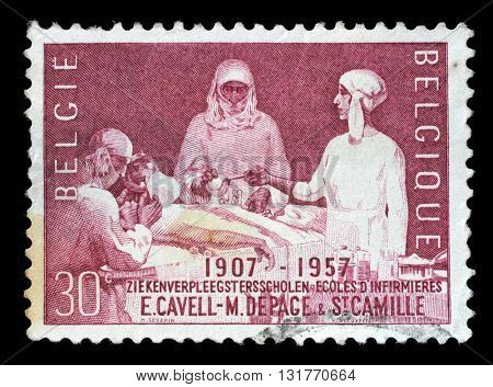 ZAGREB, CROATIA - JULY 03: A stamp printed by Belgium shows Nursing school, circa 1957, on July 03, 2014, Zagreb, Croatia