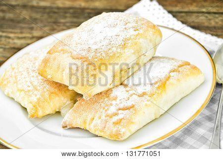 Sweet Bakery Bun with Cheese, Apple and Cinnamon. Studio Photo