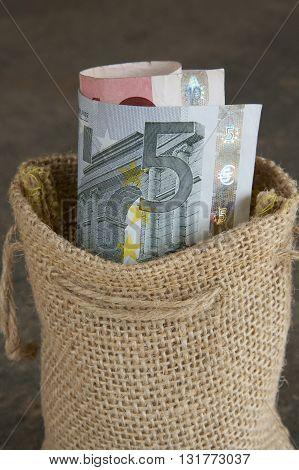 European euro notes in a hessian bag.