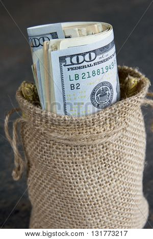 American currency in a brown hessian bag.