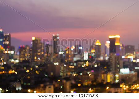 Twilight blurred city office building lights night view