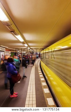 Berlin Germany - May 15 2016: metro station in Berlin with unidentified people. The metro in Berlin opened 1902 and has today 173 stations and a length of 146 km