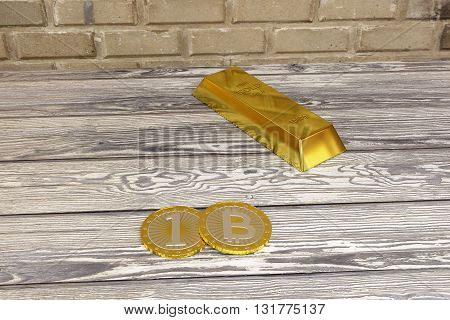 rendered gold bar and bitcoins in the basement, 3d rendering