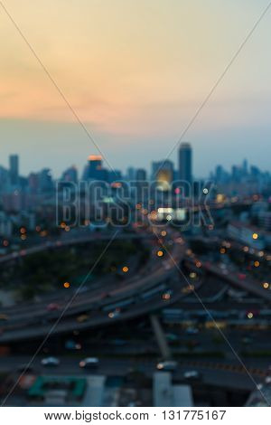 Abstract blurred lights city downtown background and highway interchanged early sunset sky