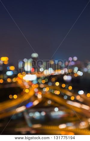 Night view, abstract blurred bokeh lights highway interchanged and city downtown background