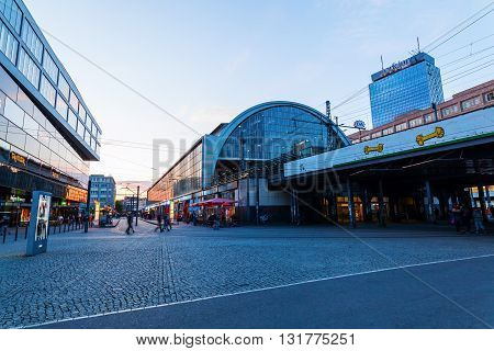 Berlin Germany - May 16 2016: Alexanderplatz in Berlin with unidentified people at dusk. is a large public square and a major transport hub in the central Mitte district of Berlin