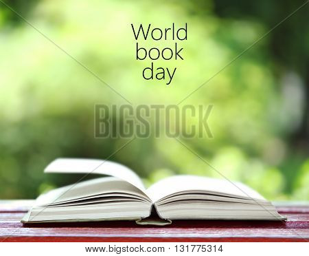 Open book on bench in park. World Book Day poster