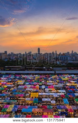 Dramatic sky during sunset over city night market