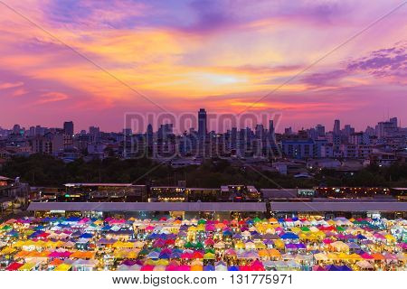 Top view, dramatic sky background after sunset over night market rooftop and city downtown background