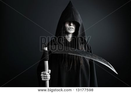 Woman death reaper over black background. Halloween.