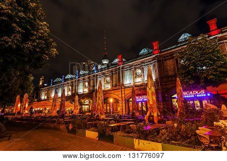 Berlin Germany - May 16 2016: night view of the Hackescher Markt S-Bahn station in Berlin. The building for the elevated S-Bahn was opened 1882 and built in Italian Renaissance style