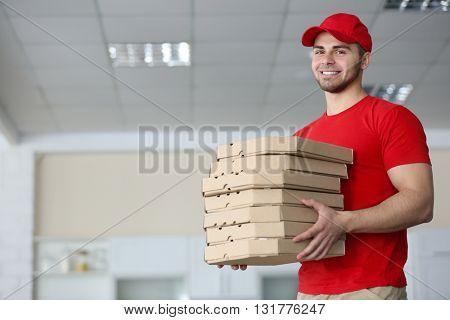 Young handsome man delivering pizza