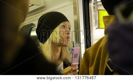 Japanese boy with blond hair in the Tokyo subway - Japan
