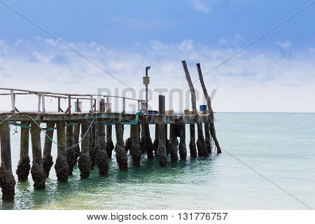 Wooden walkway leading to the ocean, natural skyline background