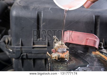Car battery corrosion on terminalDirty battery terminalsCleaning battery terminals by hot water.