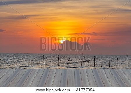 Opening wooden floor, Sunset over the seacoast, natural landscape background
