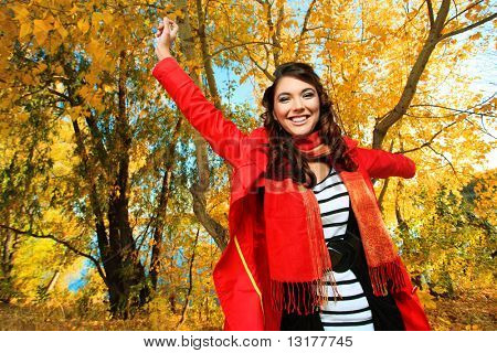 Young pretty woman at the autumn park.