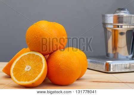 Oranges And Slices With Chrome Citrus Juicer