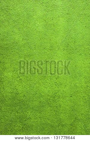 ROUGH WEATHERED WALL, BRIGHT GREEN PAINT, CLOSEUP BACKGROUND