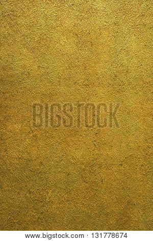 ROUGH WEATHERED WALL, BRIGHT GOLD PAINT, CLOSEUP BACKGROUND