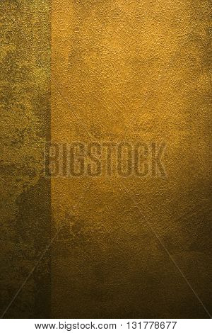 ROUGH WEATHERED WALL, BRONZE PAINT, CLOSEUP BACKGROUND