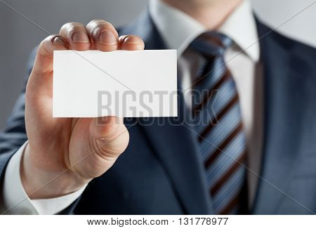 Man's hand showing business card to clients