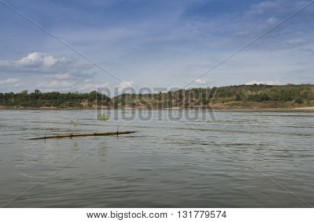 Mekong River Showing Rock Formations And Dramatic Sky And Landscapes.