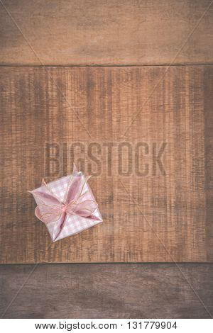 pink gift  box on wooden background .