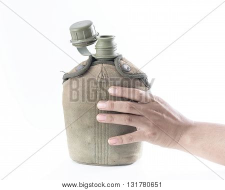 Man holding Military canteen isolated on a white background