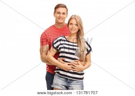Young man hugging his girlfriend and posing together isolated on white background
