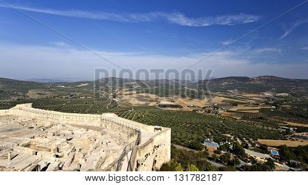 View of the olive groves surrounding the Fortaleza de La Mota and the city of Alcala la Real in Andalusia Spain