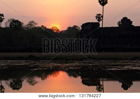Reflections of Ankor Wat temple at dawn