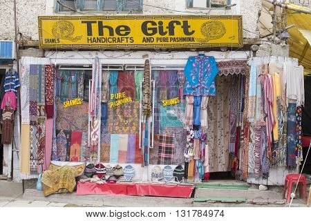 LEH INDIA - JUNE 29 2015 : Front view of Tibetan shop clothes and souvenirs outside the tourist town of Leh India